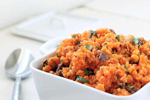 Baked Puerto Rican Rice combines sweet Italian sausage with fluffy rice and crunchy vegetables. Perfect as a main dish or side dish!