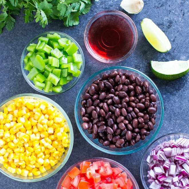 Whip up a giant batch of Black Bean Salsa in minutes! It's fresh and delicious, perfect for parties, so easy to make, and addictive! Naturally vegan and gluten free.