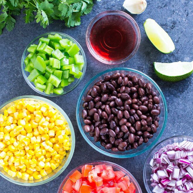 Black Bean Salsa ingredients in various bowls.