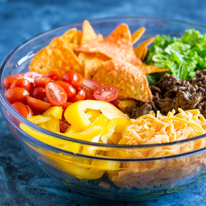 A taco salad with beef, cheese, lots of fresh veggies, and Doritos! Enjoy Dorito Taco Salad again or try it for the first time. You'll love it either way!