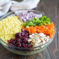 Curried Couscous Salad in a clear bowl.