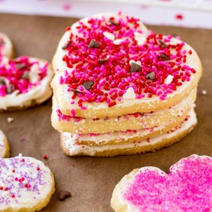 Spread the LOVE this Valentine's Day with easy frosted Valentine cookies! No matter what your baking skills are, you'll be able to tackle these simple cookies topped with royal icing and sprinkles.