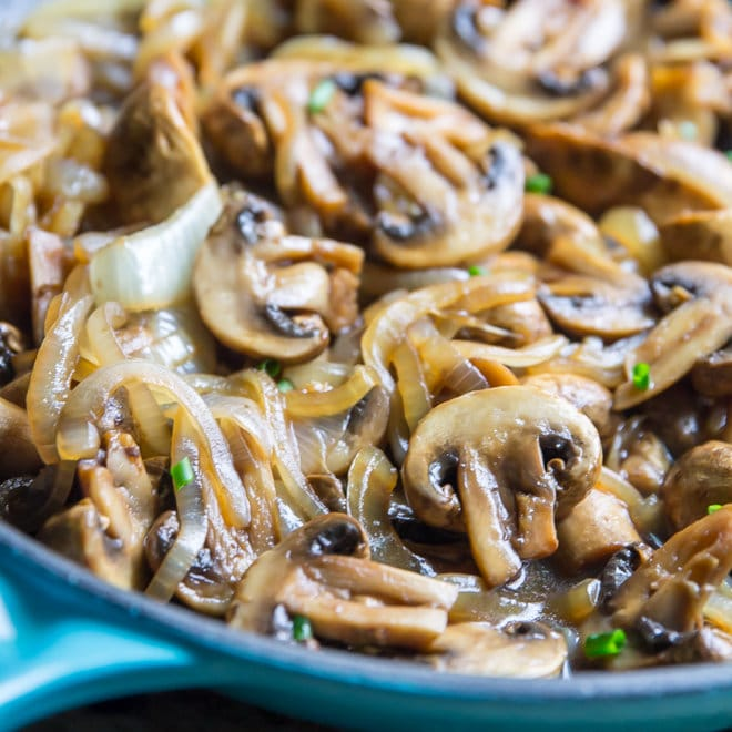 A skillet with Mushroom and Onions.