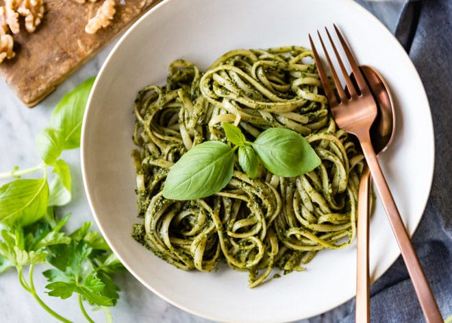 Linguine with pesto in a white bowl.