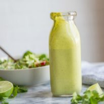 An easy, creamy Cilantro Lime Dressing recipe made with Greek yogurt! So good you'll want to eat it with a spoon. Guaranteed to brighten up any salad!