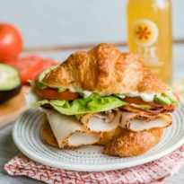 An easy recipe for a Turkey Avocado BLT Croissant Sandwich. Make this delicious Red Robin copycat at home with flaky, buttery croissants, lots of bacon, juicy tomatoes, and as much avocado as you want! Your new favorite lunch.