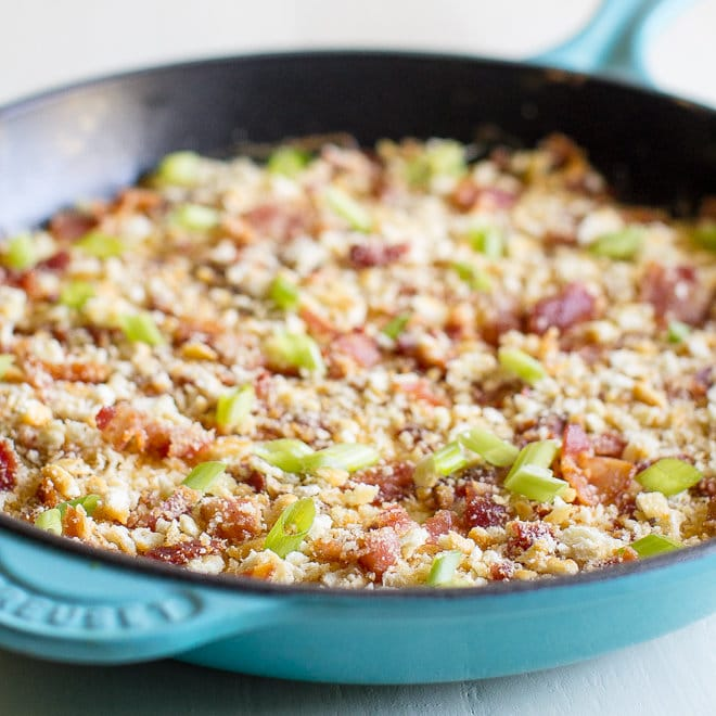 Hot Swiss Cheese and Bacon Dip in a blue skillet pan.
