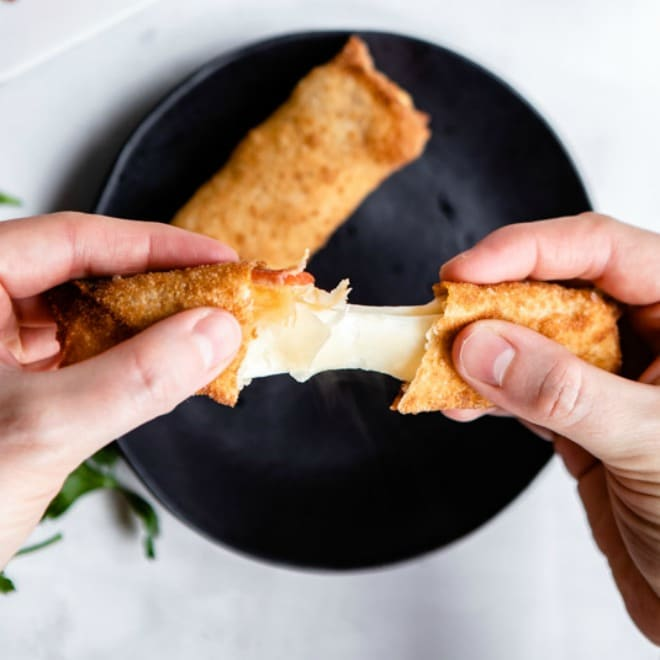 It only takes 3 ingredients to make these easy, cheesy Pizza Sticks! Wrap cheese and mini pepperonis in wonton wrappers, then fry to crispy golden perfect. So great with marinara sauce, ranch, or nacho cheese dipping sauces!
