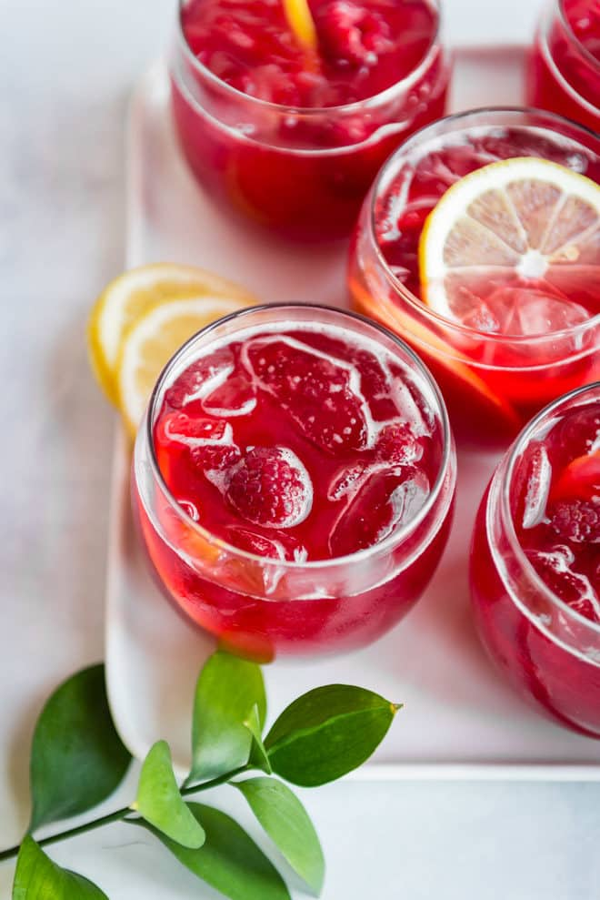 Raspberry lemonade fizz in clear glasses.