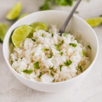 A shot of cilantro lime rice in a white bowl.