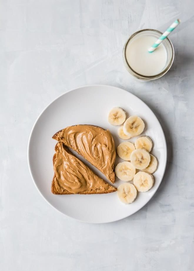 10 Toddler Breakfast Ideas - a photo of toast slices covered with peanut butter with banana slices with a white background - click photo for full written recipes
