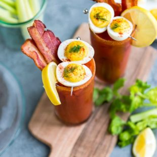 Two bacon and eggs bloody Mary cocktails.