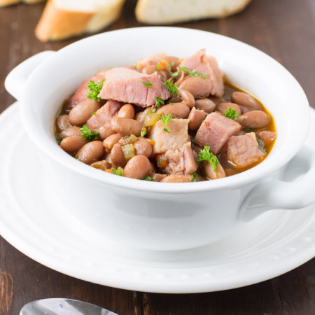 A simple, delicious way to put your leftover ham bones to work, this soup has plenty of beans and vegetables too. This slow cooker staple is perfect for cold weather! Naturally gluten free.