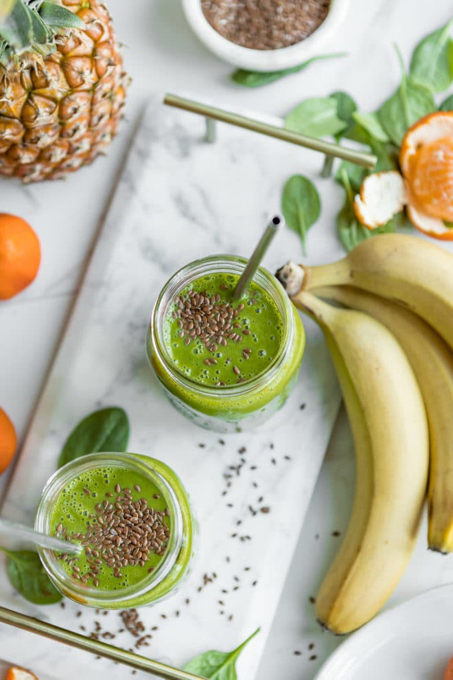 The best Green Smoothie recipe! Fresh spinach and flax seeds are sweetened with citrus and bananas. You'll be shocked at how good this tastes!