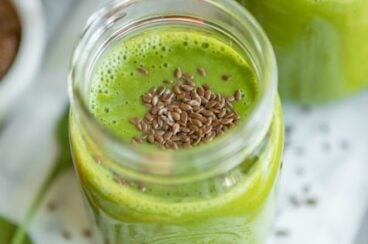 The best green smoothie in a clear mason jar.
