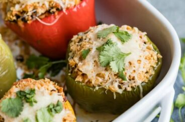 Vegetarian Stuffed Peppers in a white baking dish.