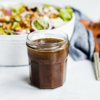 Balsamic vinaigrette in a glass jar.