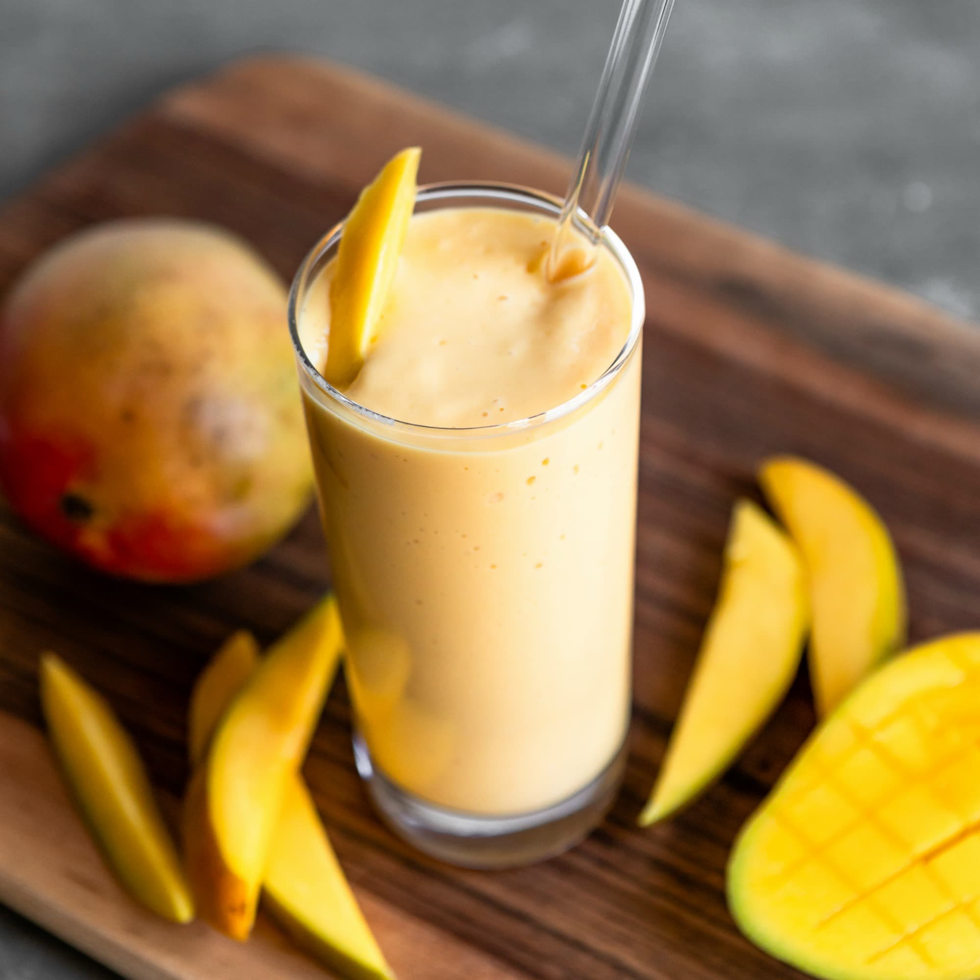 A tasty and refreshing way to start your day off right, this Tropical Mango Smoothie is made with only five ingredients and is ready in just a few minutes. Feel free to replace the mango with any one of your favorite tropical fruits such as pineapple, banana, or papaya. Or go crazy and mix them all into one!