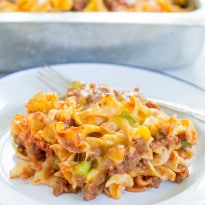 Reunion Sausage Casserole is exactly the type of hearty comfort food you'd want to take to a special occasion. It's so easy, cheesy, and delicious too!