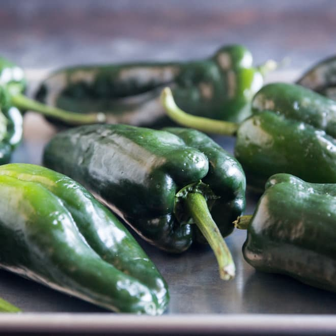 Learn how to roast peppers and chilies in the oven or on a gas burner. Use this method for bell peppers, poblanos, anaheims, pasillas, and more!