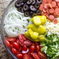 My version of a classic Italian Antipasto Salad! Plenty of pepperoni and cheese on a bed of crunchy vegetables topped with a homemade red wine vinaigrette.
