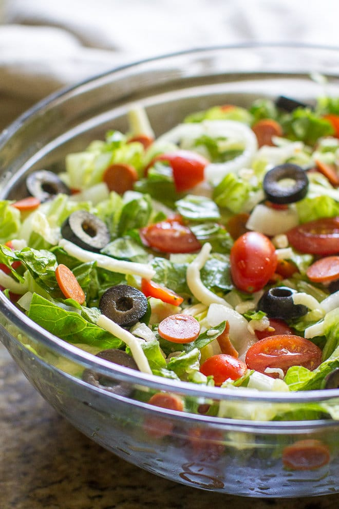 Italian Antipasto Salad in a clear bowl.
