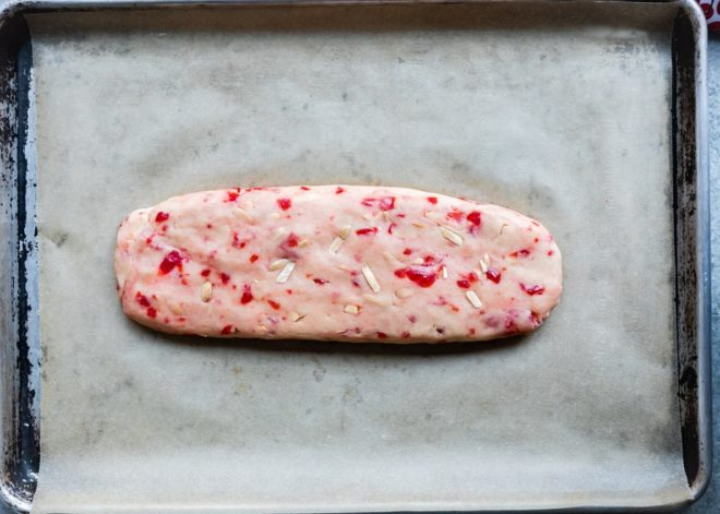 Cherry almond biscotti dough on a baking sheet.