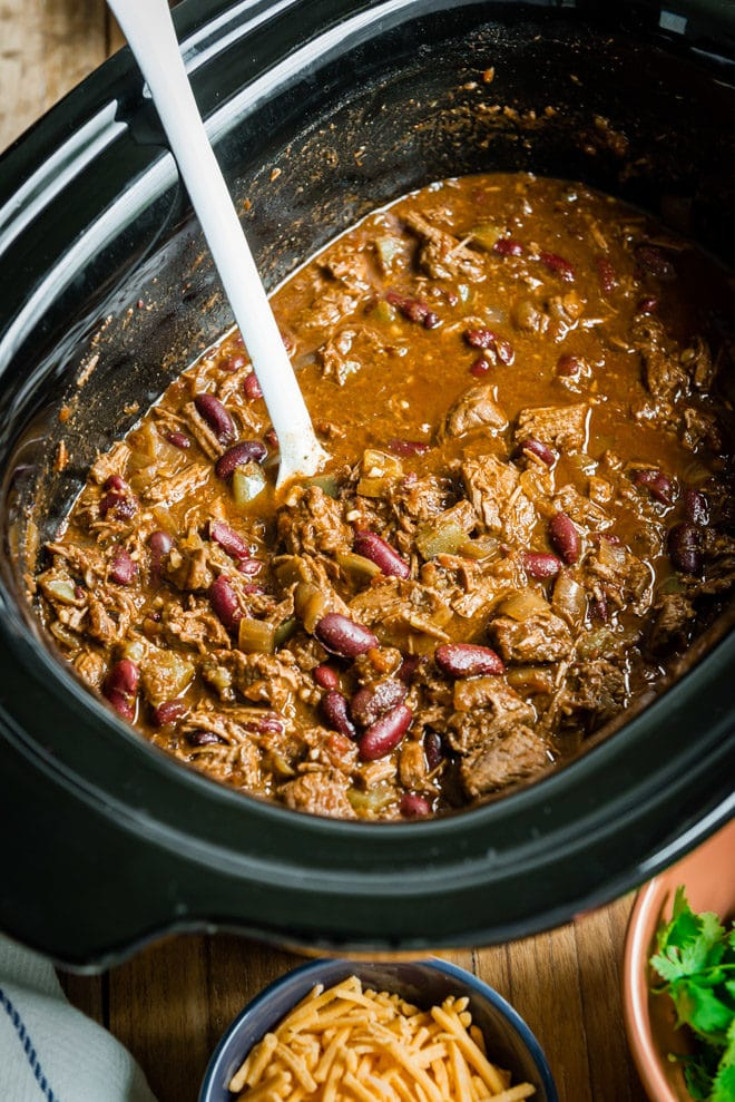 A delicious, easy recipe for Slow Cooker Chili Con Carne. Find all my tips and tricks for adding the most flavor to your chili every step of the way!