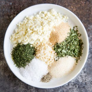 Homemade Ranch Dressing Mix ingredients separated on a white plate.