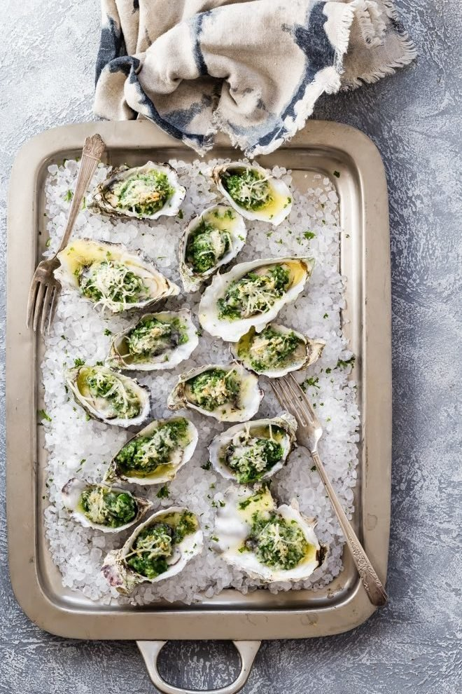 A must-make dish for any oyster aficionado, Oysters Rockefeller is a luxurious appetizer that turns any occasion into a very special one. They're perfect to serve for Mother's Day brunch, a sophisticated New Year's shindig, or even a quiet dinner at home.
