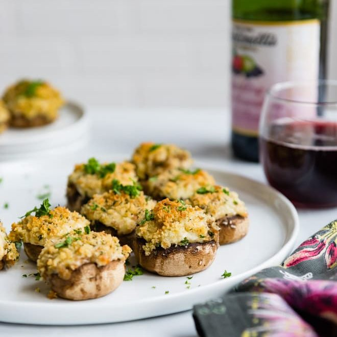 Mushroom lovers rejoice! These vegetarian Stuffed Mushrooms are loaded with marinated artichoke hearts, two cheeses, and scallions. Top them off with buttery breadcrumbs, then bake until golden brown and bubbly! Everything can be prepped and assembled the day before (in 30 minutes or less!).