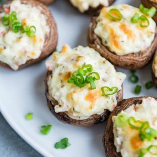 Crab Stuffed Mushrooms are rich, cheesy, and insanely addictive. You'll want to eat the filling all by itself but it's even BETTER when it's hot and bubbly!