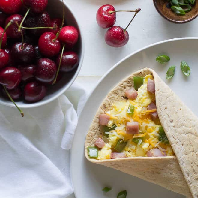 No time to make omelettes? Scramble some eggs and fake it with this Denver Omelette Breakfast Wrap. Makes a hearty Breakfast For Dinner option, too!