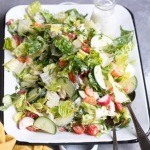 Easy garden salad on a white platter.