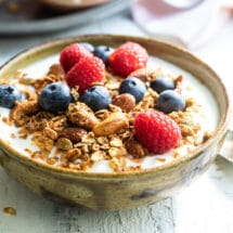 A yogurt parfait topped with berries and homemade granola.