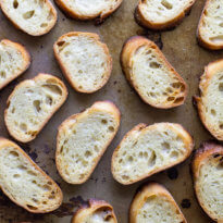 An easy Toasted Baguette recipe for making crostini for soups, salads, dips, or snacks! Just brush with olive oil and bake until lightly golden brown. Easy!
