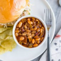Slow Cooker Baked Beansin a white dish.
