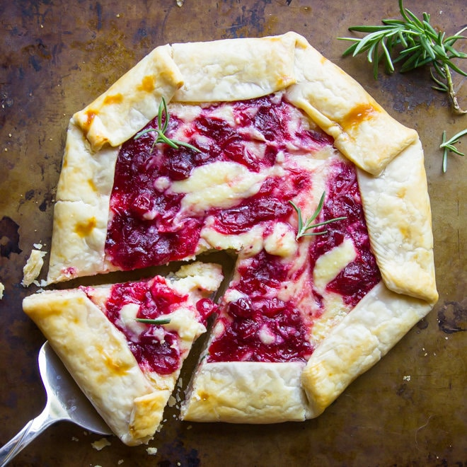 A Cranberry Cheesecake Galette with a piece being lifted out.