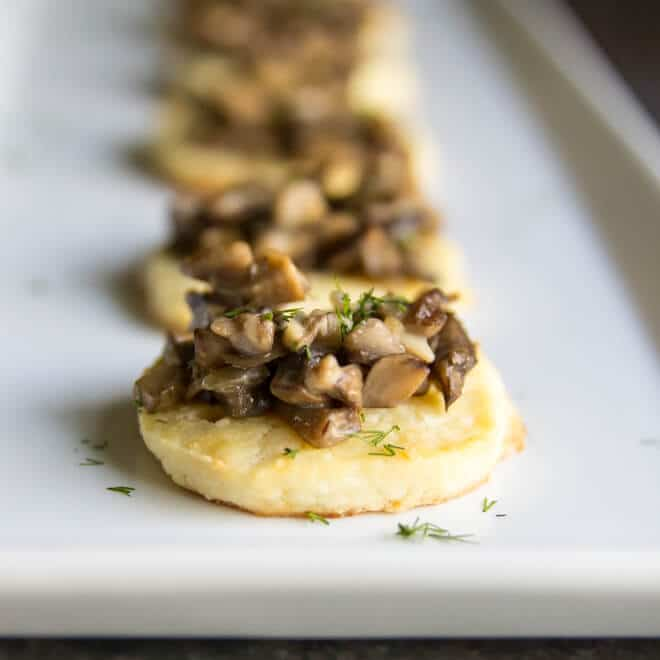 Homemade Cream Cheese Crisps with Mushroom Ragout are creamy, delicious, and deceptively easy! Make the dough ahead, then slice and bake to serve!