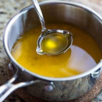 Learn how to make clarified butter, an easy process that removes the water and milk solids from whole butter. Use it for Hollandaise and many other recipes.