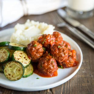 Feed a crowd with Slow Cooker Meatloaf Meatballs! Make the meatballs ahead (from scratch) and then let them simmer in the sauce in a slow cooker.