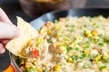 This easy Hot Corn Dip is ultra cheesy and SO TASTY! Make it with frozen corn in the winter and fresh corn in the summer (instructions for both included).