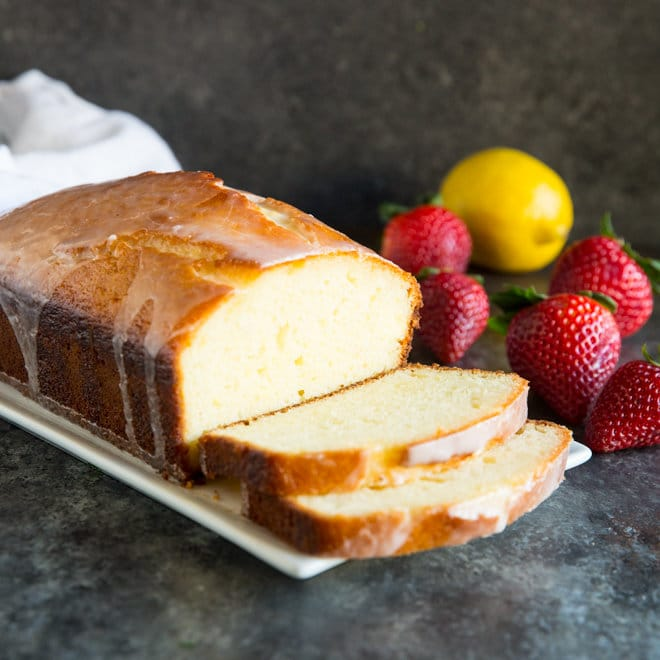 A luscious Lemon Yogurt Cake topped with a sweet lemony glaze. Perfect for dessert or brunch!