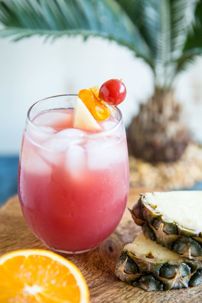 Inspired by Carnival Cruises, this Pirate Punch recipe is sweet, fruity, and tastes just like the tropics! Directions for 1 cocktail or a pitcher of 8.