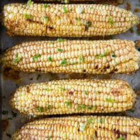 Cowboy Corn on the Cob is sweet and spicy all at once! Make it on the grill or in the oven for the perfect summer side dish. So easy and packed with flavor!