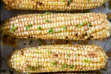 Six cowboy corn on the cobs. spicy all at once! Make it on the grill or in the oven for the perfect summer side dish. So easy and packed with flavor!