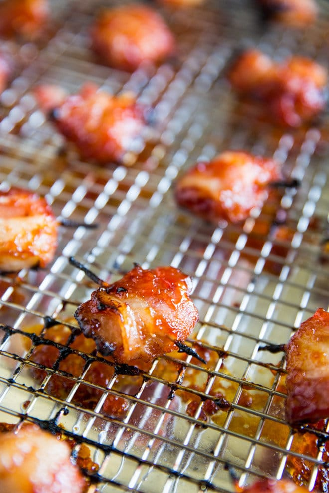 Bacon Wrapped Water Chestnuts are salty, sweet, and insanely addictive. Top with 2-ingredient barbecue sauce and broil to perfection in minutes!