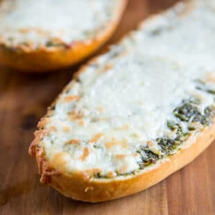 3-ingredient Pesto Cheese Bread makes a great snack or side dish! Make it on the grill or in the oven using store-bought pesto or my easy homemade version.