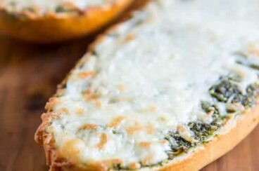 Pesto Cheese Bread on a wood board.