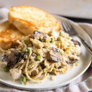 Put leftover turkey (or chicken!) to work with this easy Turkey Tetrazzini casserole. Creamy, comforting, and freezer friendly too!